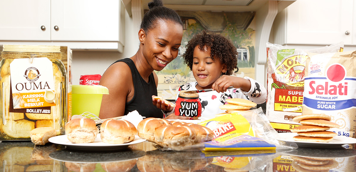 Mother and child in the kitchen with RCL FOODS Brands