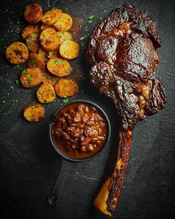 GRILLED TOMAHAWK WITH HARISSA BUTTER AND PAP CHIPS
