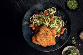 CHICKEN SCHNITZEL WITH A BASIL PESTO COURGETTE NOODLE SALAD